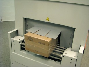Clamco Dem Combo shrink wrapped box exiting machine